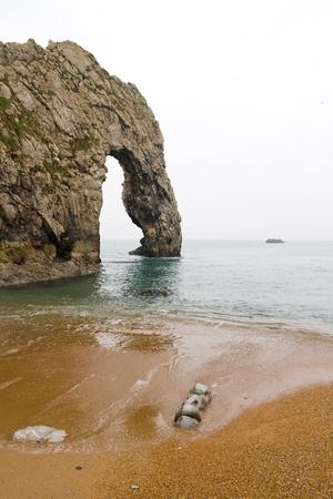 rock arch: Lulworth Cove in Durdle Door, Coastal Rock Arch Stock Photo