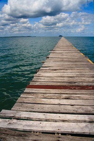 Ocean Pier with Cloudy Sky Stock Photo