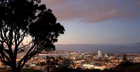 sprawl: Auckland City skyline at sunset, hilltop view, new zealand Stock Photo