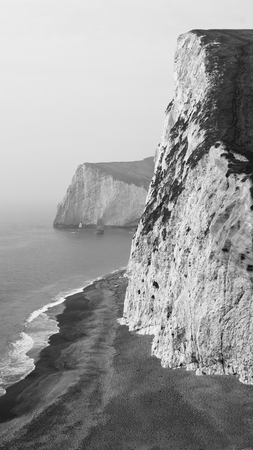 Black and White Coast Cliffs Portrait in Lulworth Cove, Dorset, South England Stock Photo