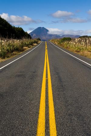 Long straight road to mt doom mountain, new zealand