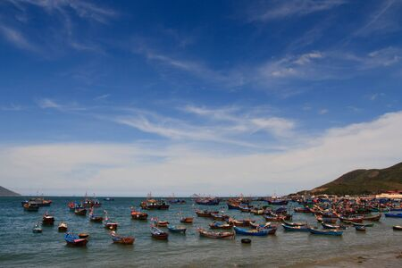 Fishing Boats covering the harbour in a Vietnam fishing port Stock Photo