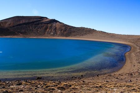 crater highlands: Togariro crossing blue volcanic lake, new zealand Stock Photo
