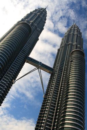 Bold Diagonal Petronas Towers with blue sky background