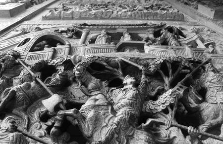 Ornate Stone Carving of Horseman in Battle