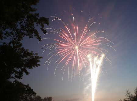 two different kinds of fireworks going off simultaneously photo