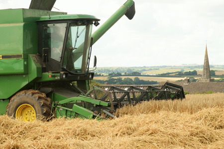 threshing: Threshing machine.Summer in England .The corn is gathered in and the bales of hay are made.