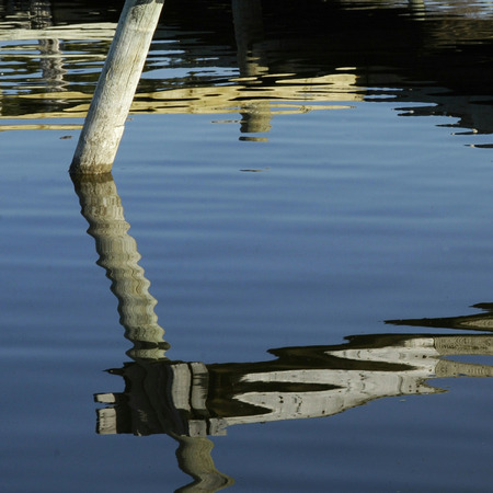 moorings: Ripples and Reflections.  Calm day at the moorings on the lake.
