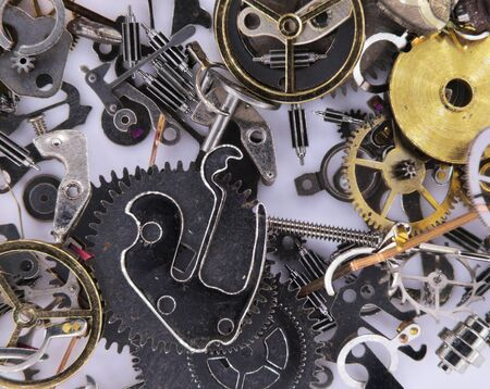 engineered: Watch Parts dismantled.Macro study of  precisely engineered watch parts.