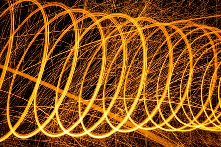 steel wool: Circles pattern made with lighted steel wool spinning in the dark Stock Photo