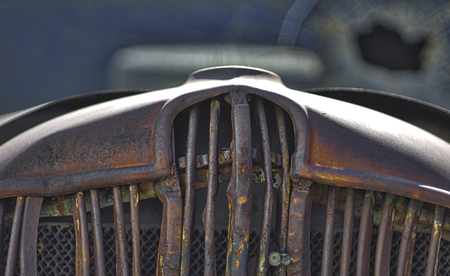 Grizzled grill of old junk car