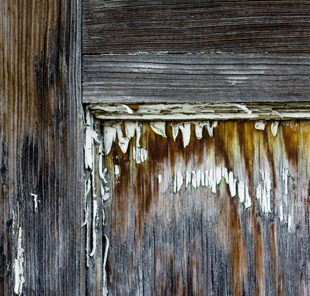 out dated: Detail of a salvage wood door, probably from a cabin or old house, spotted in a junkyard.