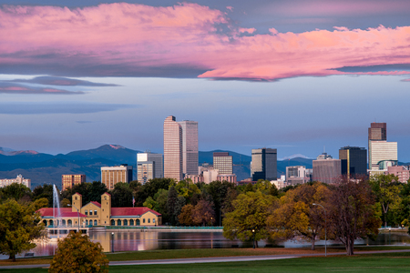 denver skyline with mountains: Denver downtown skyline at sunrise with colorful clouds Stock Photo