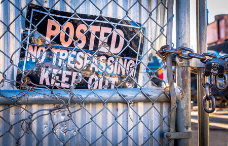 trespassing: No trespassing sign and fence Stock Photo
