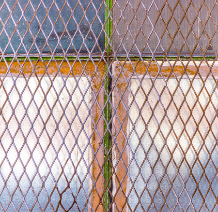 old window: Urban cross: industrial buildings old window