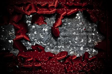 pealing: A gunge look at some galvinized metal with rich red paint peeling, providing a myriad of textures and light. Stock Photo