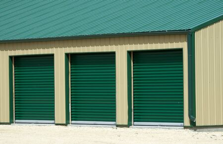 shed: Three Green Garage Doors