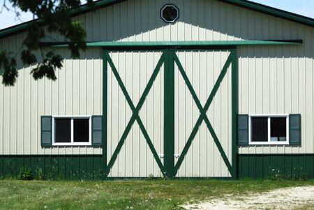 X Doors on White and Green Barn Stock Photo - 3289098