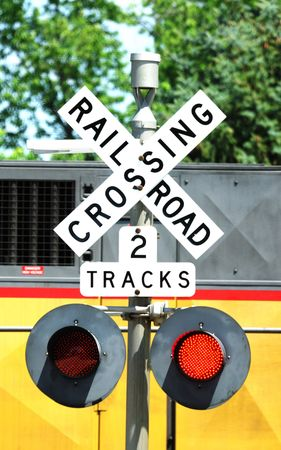 Train Passing Railroad Crossing Sign Banco de Imagens
