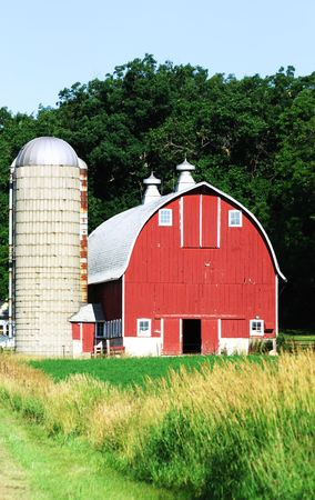 Red Barn by Gray Silo Stock Photo