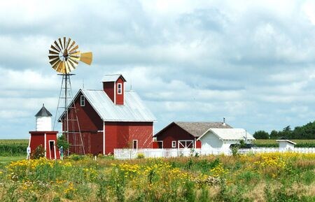 barns: Windmill, Barn, Sheds and Fence on a Cloudy Day