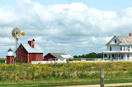 Windmill, Barn, Sheds, and  on a Cloudy Day photo
