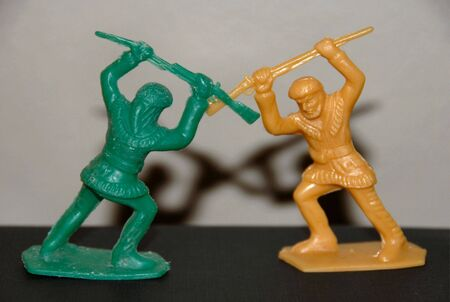 Two Fighting Toy Pioneers with Shadows photo