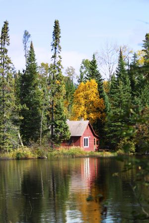 cabin: Red Cabin in the Woods by Lake