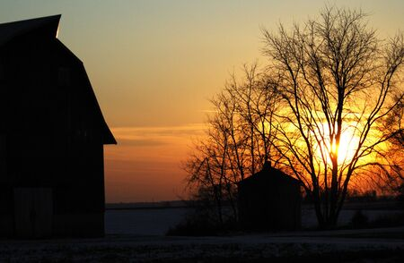 Silhouette of Barn and Shed at Sunset photo