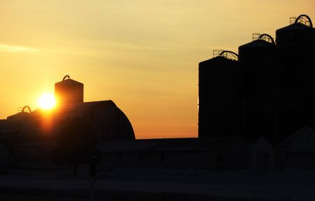 Silhouette of Barn and Silos at Sunset Stock Photo - 4018681