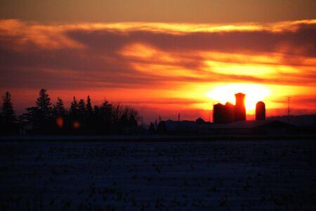 Fiery Sunset Behind the Farm Stock Photo - 4076506