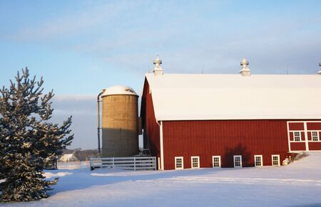 Red Barn in the Snow by Evergreen Tree Stock Photo - 4120908