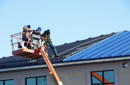 Construction Workers on Blue Roof