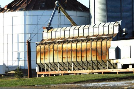 dryer: Grain Dryer by the Bins Stock Photo