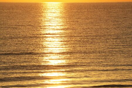 Sunrise Reflected on Atlantic Ocean Stock Photo