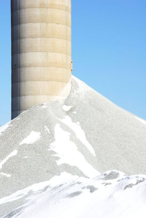Crushed Rock by Concrete Silo