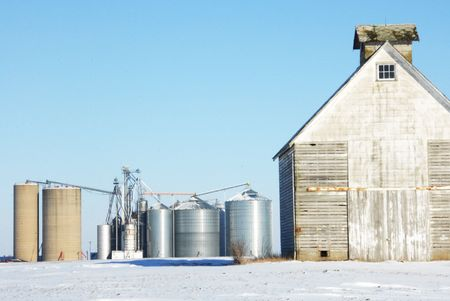 Grain Bins and White Storage Shed Stock Photo - 4697529
