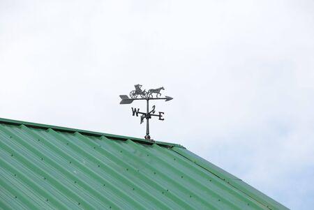 vane: Weather Vane on Cloudy Day Stock Photo