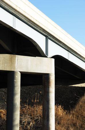 Concrete Pier Under Steel Bridge photo