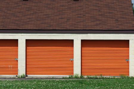Three Orange Self-Storage Garage Doors Stock Photo - 5749705