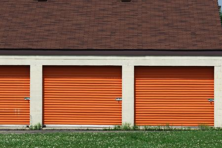 Three Orange Self-Storage Garage Doors Stock Photo - 5749705