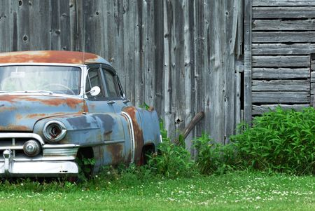 Old Car by Weathered Barn