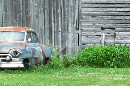 Old Blue Car by Weatherd Barn