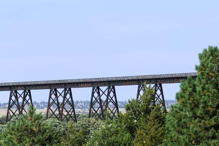 trestle: Railroad Trestle Over Trees Stock Photo