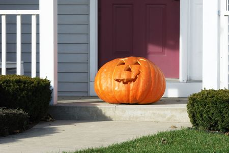Big Jack-O'Lantern on the Front Porch Stock Photo - 7084125