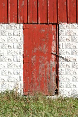 Red Barn Door in White Concrete Block Wall photo