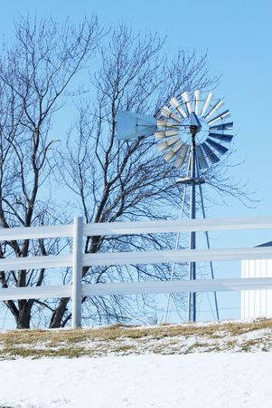 Silver Windmill and Bllue Sky photo