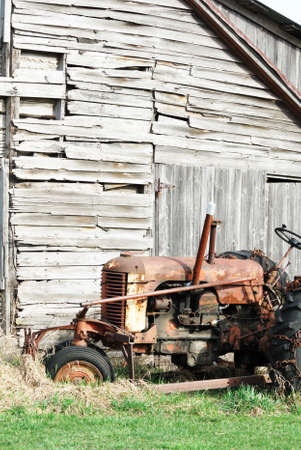 Old Tractor by Weathered Shed Banco de Imagens