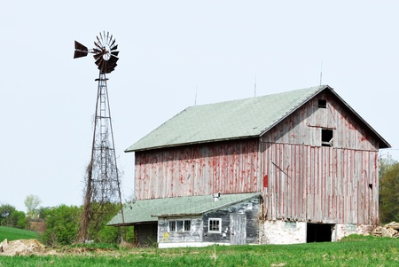 Windmill and Weathered Red Barn photo