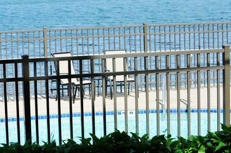 Chairs by Pool and Lake 版權商用圖片